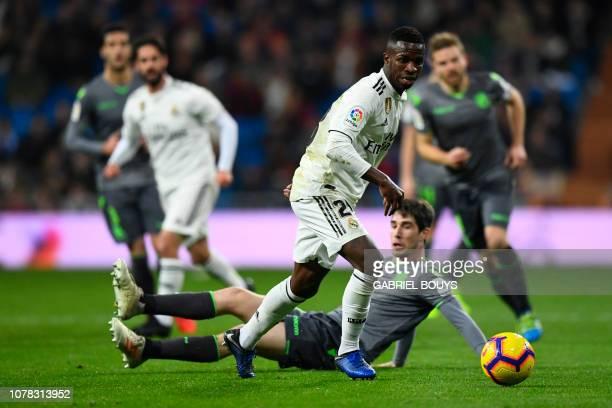 Real Madrid's Brazilian forward Vinicius Junior vies with Real Sociedad's Spanish defender Aritz Elustondo during the Spanish League football match...
