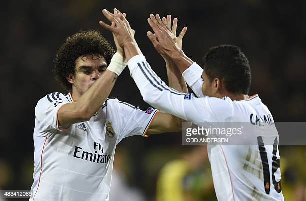Real Madrid's Brazilian midfielder Carlos Henrique Casemiro and Real Madrid's Portuguese defender Pepe celebrate after the UEFA Champions League...