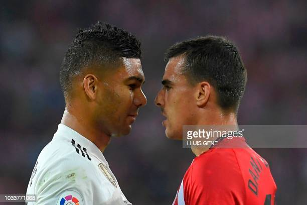Real Madrid's Brazilian midfielder Casemiro and Athletic Bilbao's Spanish midfielder Dani Garcia argue during the Spanish league football match...