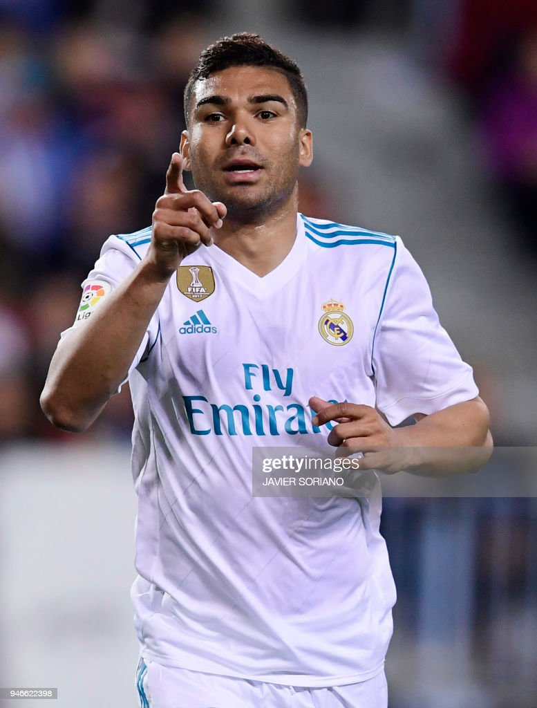 Real Madrid's Brazilian midfielder Casemiro celebrates a goal during the Spanish league footbal match between Malaga CF and Real Madrid CF at La Rosaleda stadium in Malaga on April 15, 2018. /