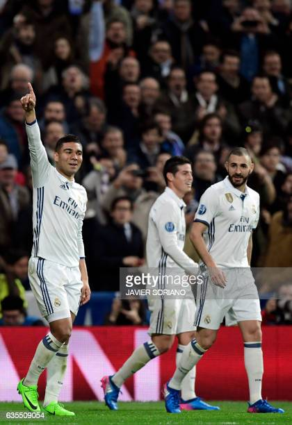 Real Madrid's Brazilian midfielder Casemiro celebrates a goal with Real Madrid's French forward Karim Benzema and Real Madrid's Colombian midfielder...