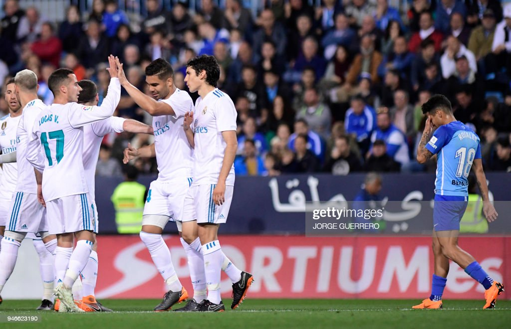 Real Madrid's Brazilian midfielder Casemiro (3R) celebrates a goal with teammates during the Spanish league footbal match between Malaga CF and Real Madrid CF at La Rosaleda stadium in Malaga on April 15, 2018. /