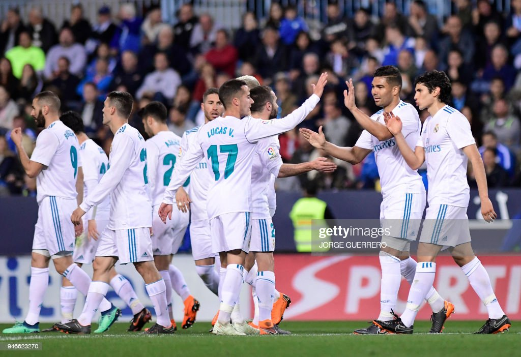 Real Madrid's Brazilian midfielder Casemiro (2R) celebrates a goal with teammates during the Spanish league footbal match between Malaga CF and Real Madrid CF at La Rosaleda stadium in Malaga on April 15, 2018. /