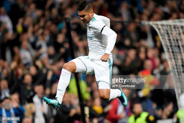 Real Madrid's Brazilian midfielder Casemiro celebrates after scoring a goal during the Spanish league football match Real Madrid CF vs UD Las Palmas...