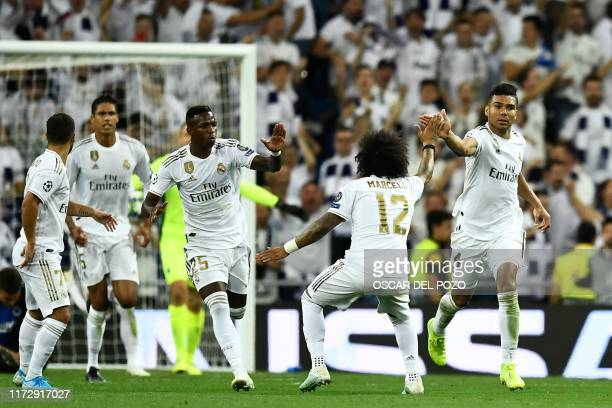 TOPSHOT Real Madrid's Brazilian midfielder Casemiro celebrates after scoring during the UEFA Champions league Group A football match between Real...
