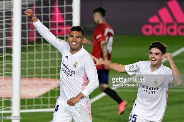 Real Madrid's Brazilian midfielder Casemiro celebrates after scoring during the Spanish League football match between Real Madrid and Osasuna at the...