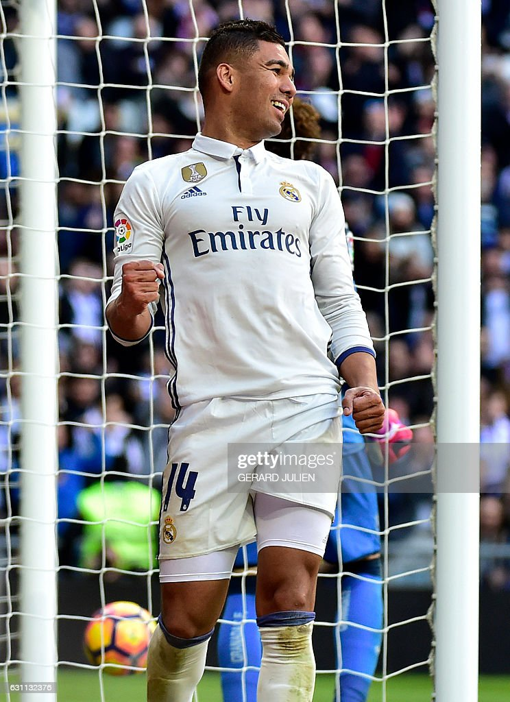 Real Madrid's Brazilian midfielder Casemiro celebrates after scoring during the Spanish league football match Real Madrid CF vs Granada FC at the Santiago Bernabeu stadium in Madrid on January 7, 2017. / AFP / GERARD