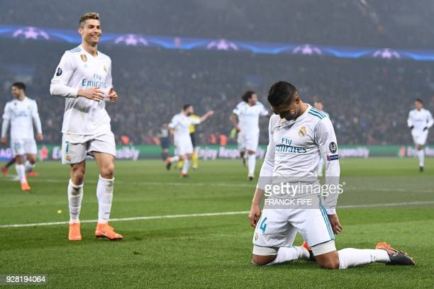 TOPSHOT Real Madrid's Brazilian midfielder Casemiro celebrates with Real Madrid's Portuguese forward Cristiano Ronaldo after scoring his team's...