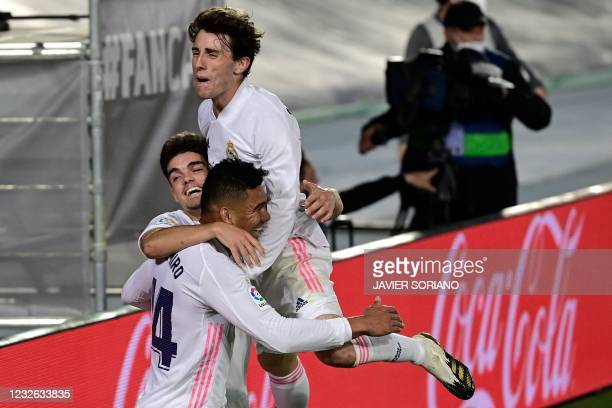 Real Madrid's Brazilian midfielder Casemiro celebrates with teammates after scoring during the Spanish League football match between Real Madrid and...