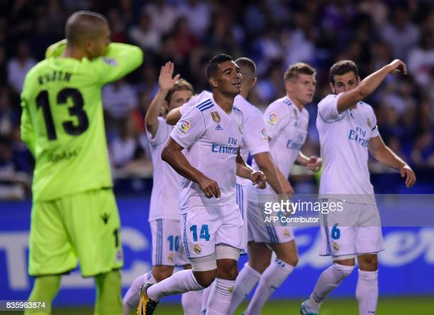 Real Madrid's Brazilian midfielder Casemiro celebrates with teammates after scoring a goal during the Spanish league footbal match RC Deportivo de la...