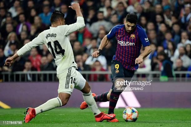 Real Madrid's Brazilian midfielder Casemiro fouls Barcelona's Uruguayan forward Luis Suarez during the Spanish Copa del Rey semi-final second leg...