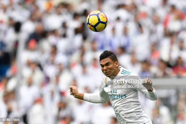 Real Madrid's Brazilian midfielder Casemiro heads the ball at the Santiago Bernabeu stadium in Madrid during the Spanish league football match Real...