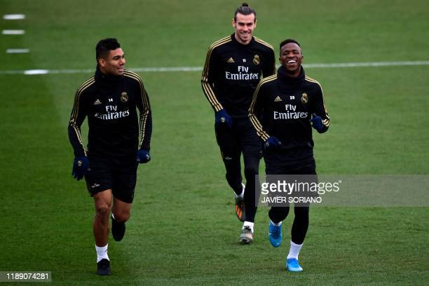 Real Madrid's Brazilian midfielder Casemiro Real Madrid's Brazilian forward Vinicius Junior and Real Madrid's Welsh forward Gareth Bale attend a...