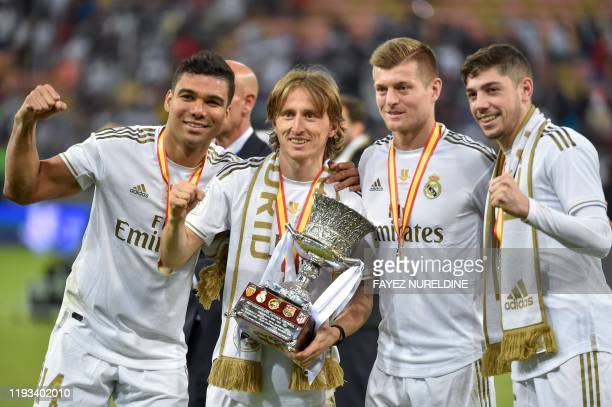 TOPSHOT Real Madrid's Brazilian midfielder Casemiro Real Madrid's Croatian midfielder Luka Modric Real Madrid's German midfielder Toni Kroos and Real...