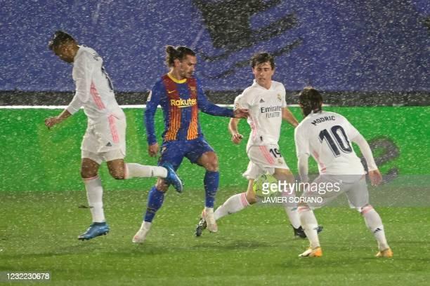 Real Madrid's Brazilian midfielder Casemiro, Real Madrid's Spanish defender Alvaro Odriozola and Real Madrid's Croatian midfielder Luka Modric...