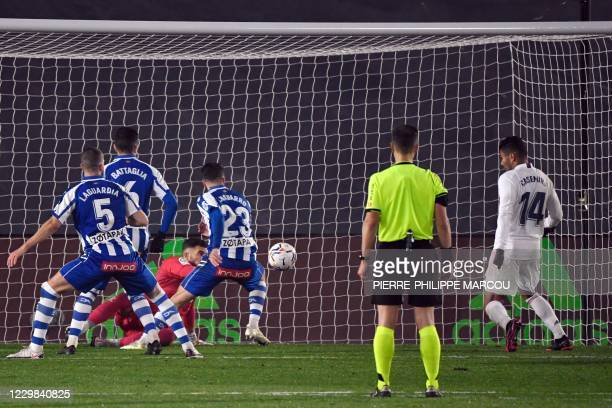 Real Madrid's Brazilian midfielder Casemiro scores a goal during the Spanish League football match between Real Madrid and Deportivo Alaves at the...