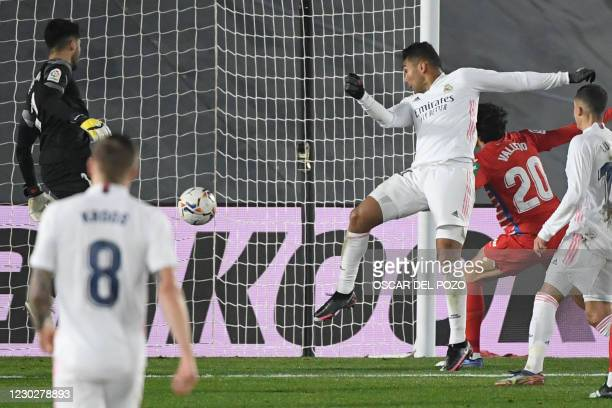 Real Madrid's Brazilian midfielder Casemiro scores a goal during the Spanish league football match between Real Madrid CF and Granada FC at the...