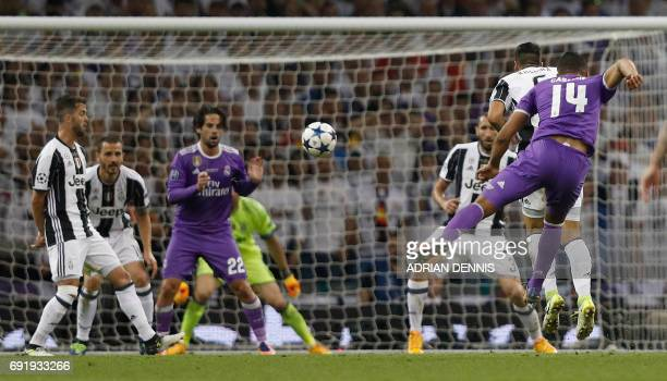 TOPSHOT Real Madrid's Brazilian midfielder Casemiro shoots and scores their second goal during the UEFA Champions League final football match between...