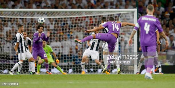 Real Madrid's Brazilian midfielder Casemiro shoots and scores their second goal during the UEFA Champions League final football match between...