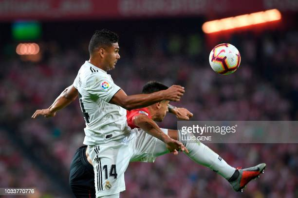 Real Madrid's Brazilian midfielder Casemiro vies with Athletic Bilbao's Spanish defender Yuri Berchiche during the Spanish league football match...