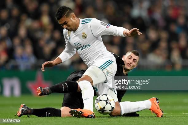 Real Madrid's Brazilian midfielder Casemiro vies with Paris SaintGermain's Italian midfielder Marco Verratti during the UEFA Champions League round...