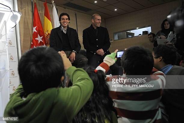 Real Madrid's Brazilian midfielder Kaka and French former football player Zinedine Zidane pose for children at Santiago Bernabeu stadium in Madrid on...