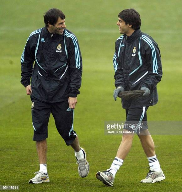 Real Madrid's Brazilian midfielder Kaka and teammate Dutch forward Ruud van Nistelrooy joke during the first trainning session after Christmas...
