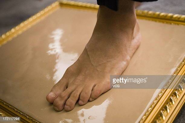 Real Madrid's Brazilian midfielder Kaka makes his footprints prior to the Grand SinoBrazil Cultural and Sports Exchange Activities and SinoBrazil...