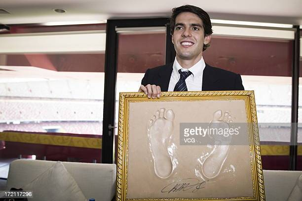 Real Madrid's Brazilian midfielder Kaka poses with his footprints prior to the Grand SinoBrazil Cultural and Sports Exchange Activities and...