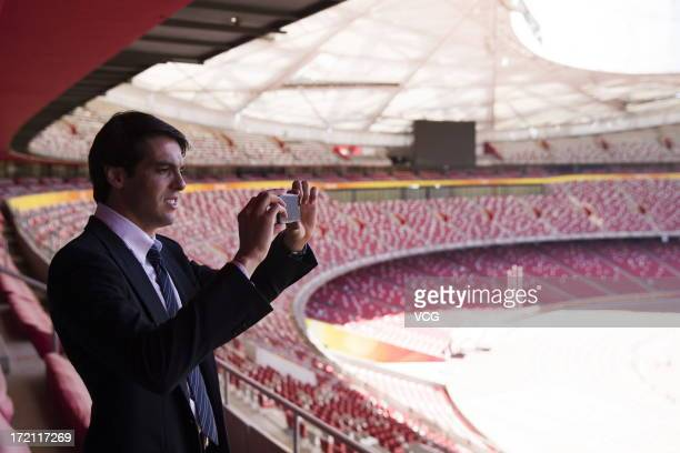 Real Madrid's Brazilian midfielder Kaka takes photos with his smartphone as he visits the National Stadium on July 2, 2013 in Beijing, China.