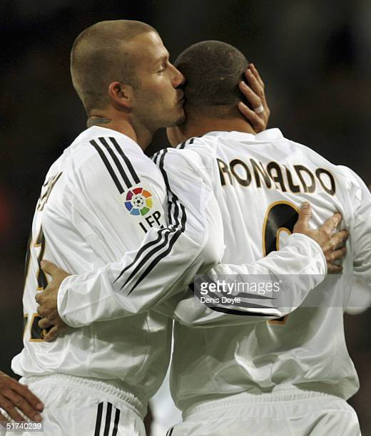 Real Madrids Brazilian player Ronaldo celebrates with David Beckham of England after scoring a goal in a Primera Liga soccer match against Albacete...