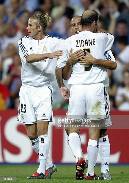Real Madrid's Brazilian Ronaldo celebrates his goal with teammates Britain's David Beckham and Frenchman Zinedine Zidane during their Champions...