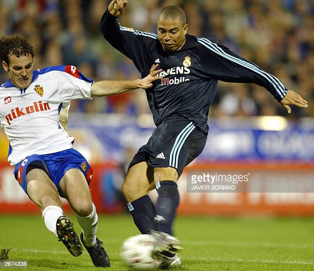 Real Madrid's Brazilian Ronaldo kicks the ball in front of Zaragoza's Argentinian Gabriel Milito during their Spanish League match Zaragoza against...