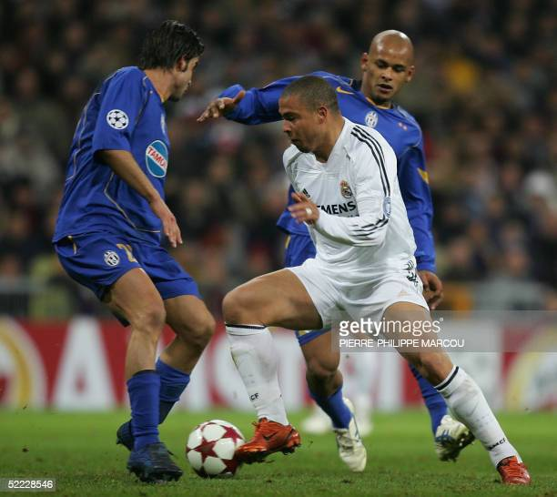 Real Madrid's Brazilian Ronaldo vies with Juventus's Manuele Blasi and Ruben Olivera during their European Champions League football match in Madrid...