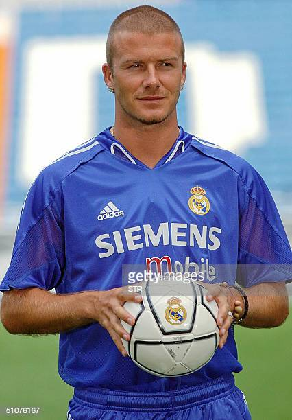 Real Madrid's British midfielder David Beckham poses 16 July 2004 at Santiago Bernabeu stadium with the club's next season equipment AFP PHOTO/STR
