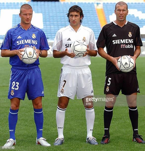 Real Madrid's British midfielder David Beckham Spanish striker Raul Gonzalez and French midfielder Zinedine Zidane pose 16 July 2004 at Santiago...
