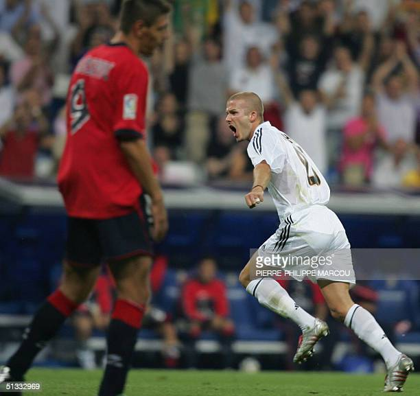 Real Madrid's Briton David Beckham celebrates his goal against Osasuna during a Premier League football match between Real Madrid and Osasuna in...