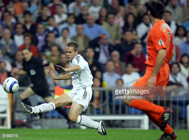 Real Madrid's Briton Michael Owen shoots a ball in front of Valencia's Carlos Marchena during their Spanish Premier League football match at Santiago...