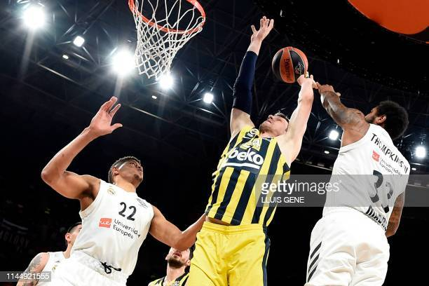 Real Madrid's Cape Verdean centre Walter Tavares and Real Madrid's US forward Trey Thompkins challenge Fenerbahce's Czech centre Jan Vesely during...
