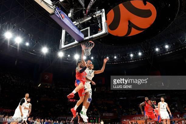 Real Madrid's Cape Verdean centre Walter Tavares challenges CSKA Moscow's Italian guard Daniel Hackett during the EuroLeague semi-final basketball...