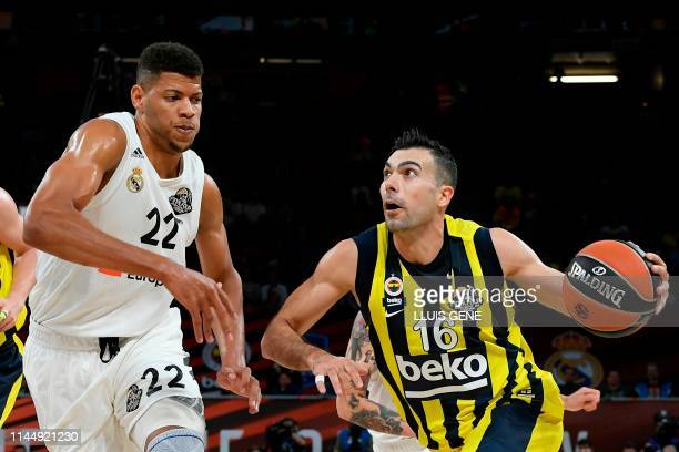 Real Madrid's Cape Verdean centre Walter Tavares challenges Fenerbahce's Greek guard Kostas Sloukas during the EuroLeague third place playoff...