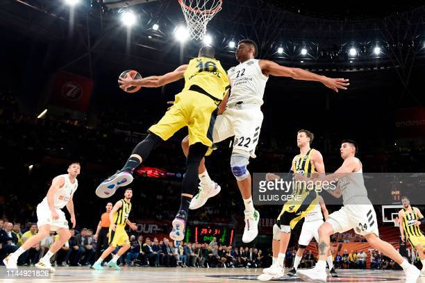 Real Madrid's Cape Verdean centre Walter Tavares challenges Fenerbahce's Greek guard Kostas Sloukas during the EuroLeague third place play-off...