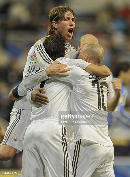 Real Madrid's captain forward Raul is congratuled by his teamates defender Sergio Ramos and Dutch midfielder Wesley Sneijder after scoring during the...