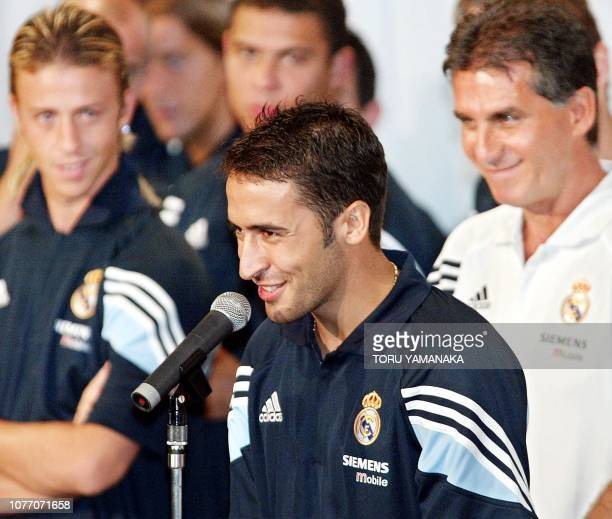 Real Madrid's captain Raúl González delivers a speech during a welcoming reception for the Spanish soccer champion while his teammate Guti , Ronaldo...
