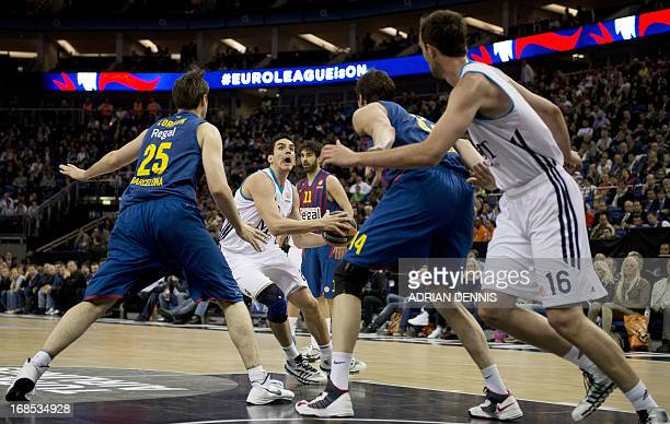Real Madrid's Carlos Suarez tries to break through the Barcelona defence during their Euroleague 2013 Final Four semifinal basketball game at the O2...