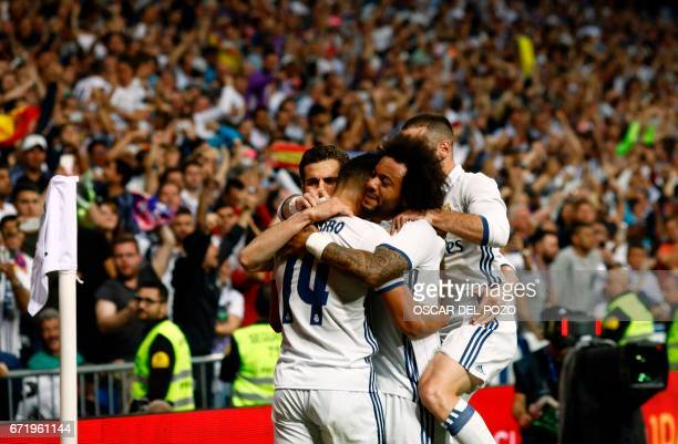 Real Madrid's Casemiro celebrates a goal with teammates during the Spanish league football match Real Madrid CF vs FC Barcelona at the Santiago...