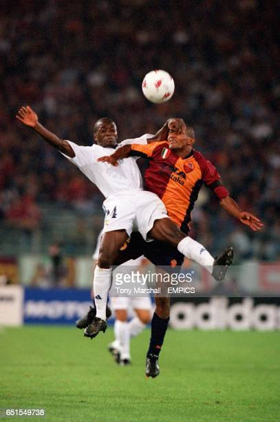 Real Madrid's Claude Makelele and Roma's Aldair battle for the ball