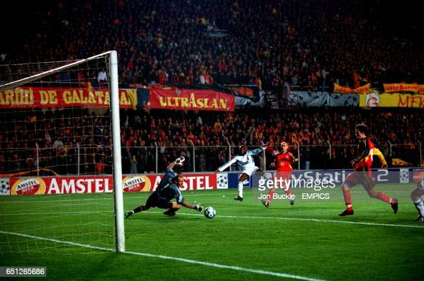 Real Madrid's Claude Makelele fires the ball past Galatasaray goalkeeper Claudio Taffarel to give his team a 20 lead