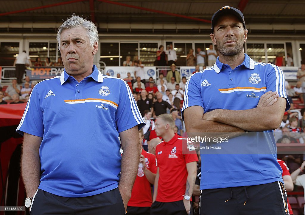 Real Madrid's coach Carlo Ancelotti (L) and assistant Zinedine Zidane looks on as his team play during the pre-season friendly football match between Bournemouth and Real Madrid at the Goldsands Stadium in Bournemouth, England on July 21, 2013 at Goldsands Stadium on July 21, 2013 in Bournemouth, England.