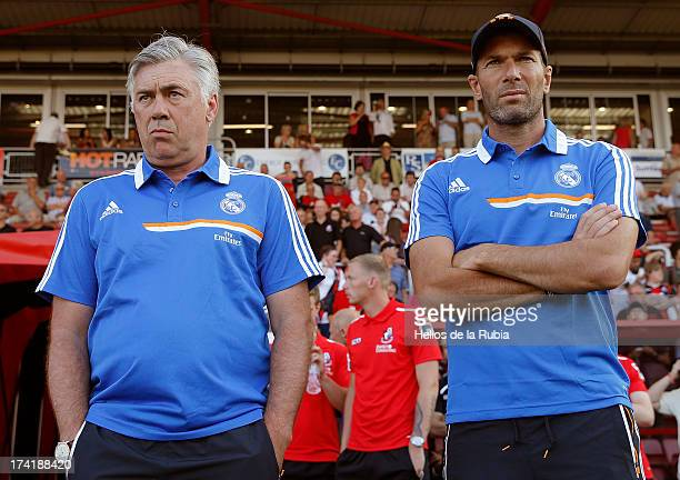 Real Madrid's coach Carlo Ancelotti and assistant Zinedine Zidane looks on as his team play during the preseason friendly football match between...